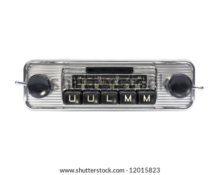 Old auto radio isolated on white. Front view. - stock photo