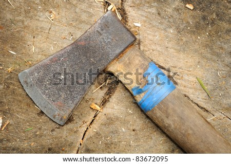 Old Axe on Tree Stump - stock photo
