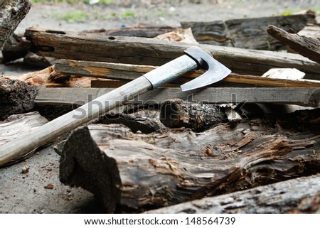 Old axe over firewood