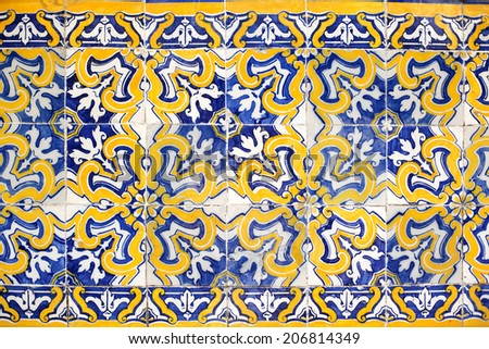 Old azulejos pattern on the building's exterior in Porto, Portugal. - stock photo