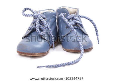 Old baby shoes isolated on white background - stock photo