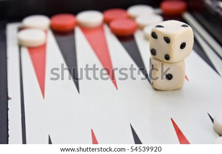 old backgammon board with scratch dice - stock photo