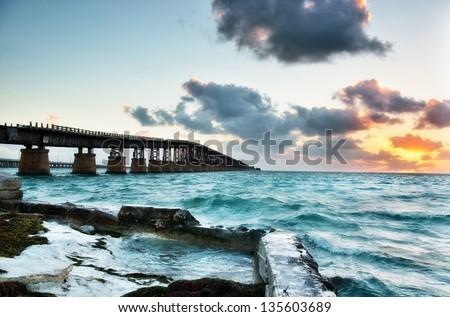 Old Bahia Honda Railroad bridge at sunrise. Florida Keys Islands, USA. - stock photo