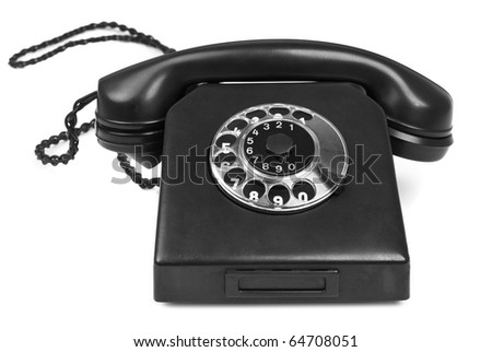 old bakelite telephone on white background, gentle natural shadow in front