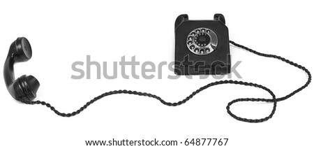 old bakelite telephone with long cable on white - stock photo
