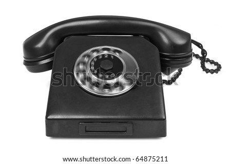 old bakelite telephone with spining dial on white, gentle natural shadow in front