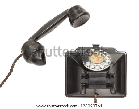 Old bakelite telephone with the receiver off the hook. GPO 200 Series. 232 model. Shot from above. Isolated on white with clipping path - stock photo