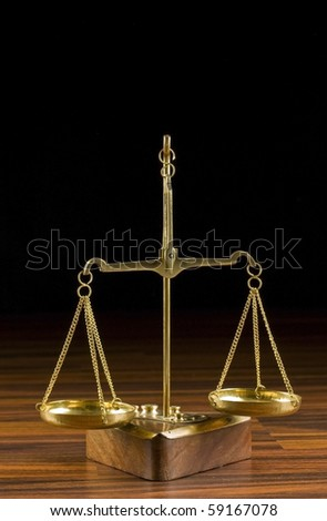 old balance  in wood background - stock photo