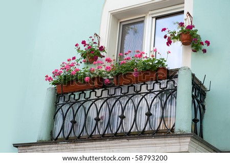 old balcony with flowers. Sankt-Peterburg - stock photo