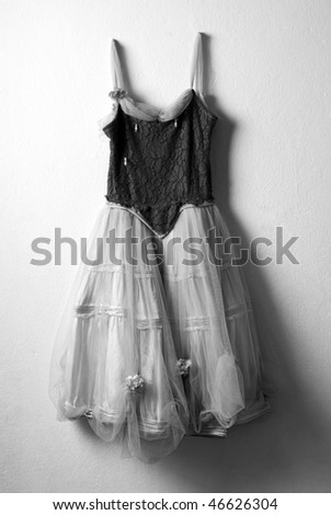 Old ballet dress hanged on the wall - stock photo