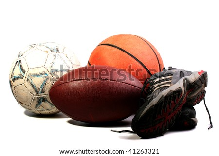 Old balls for game in football, basketball and socker together with old sports footwear.