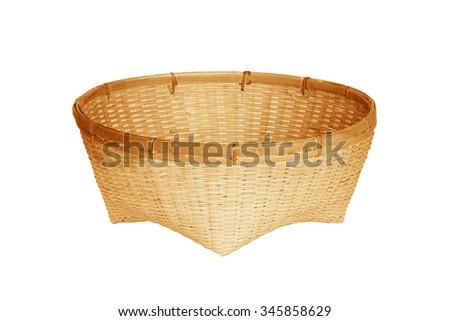 old bamboo basket isolated on white background - stock photo