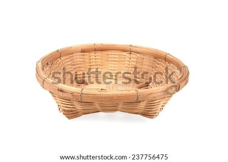old bamboo basket on white background - stock photo