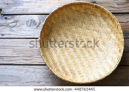 Old bamboo Basket Placed on a wooden background, Natural Tray Weave by Leaves, top view, - stock photo