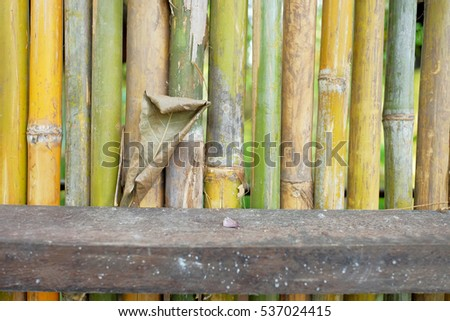 Old bamboo fence, the local traditional Asian living home style using nature strong bamboo decorate the house or cottage for safety, strong, air transfer good for tropical country