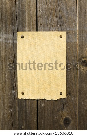 Old Bamboo Paper On Dark Wooden Texture. Ready For Your Message. - stock photo