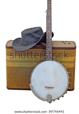Old banjo, hat and suitcase isolated on white.