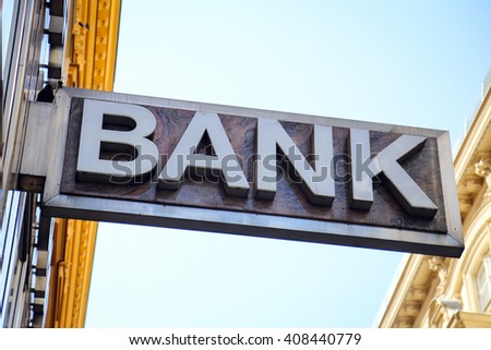 Old 'Bank' sign on a building exterior. - stock photo