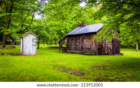 Old barn and outhouse at Millbrook Village, at Delaware Water Gap National Recreational Area, New Jersey. - stock photo