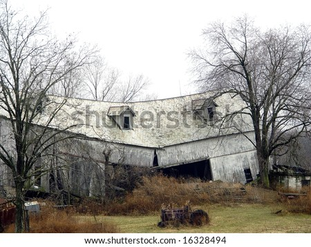 Old barn broken in half due to storm or age