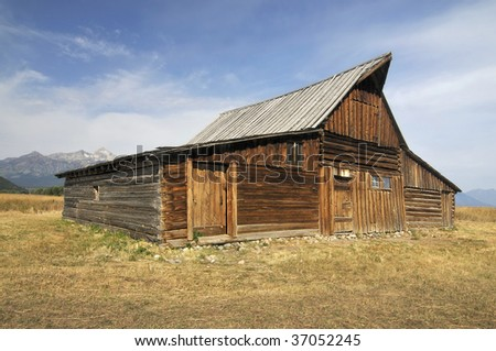 Old Barn by the Mountains - stock photo
