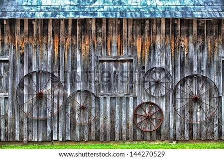 Old Barn , decorated with Metal Wheels in Tennessee