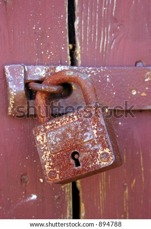 Old barn detail - locked door. - stock photo
