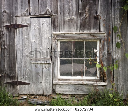 Old barn door and window - stock photo