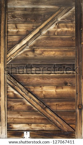 Old barn door wood textured with slanted braces - stock photo