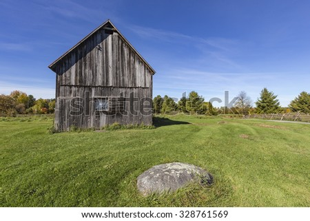 Old barn in a field - stock photo