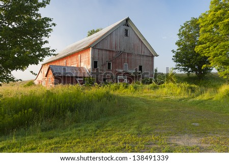 Old barn in a rural setting. - stock photo