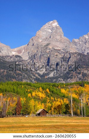 Old barn in front of Grand Tetons range - stock photo