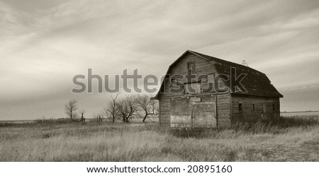 old barn in prairie - stock photo
