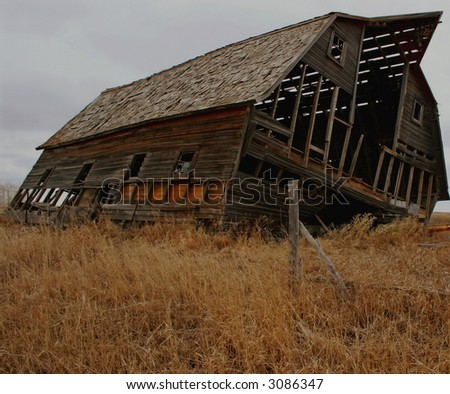 Old Barn ready to collapse in rural Alberta - stock photo