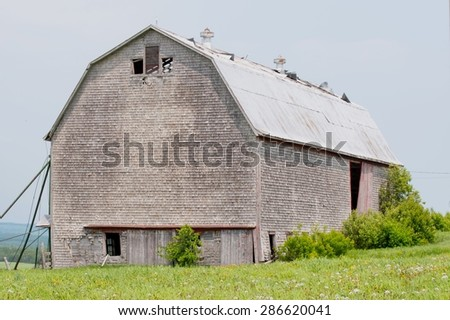 Old Barn (taken from the road side) - stock photo