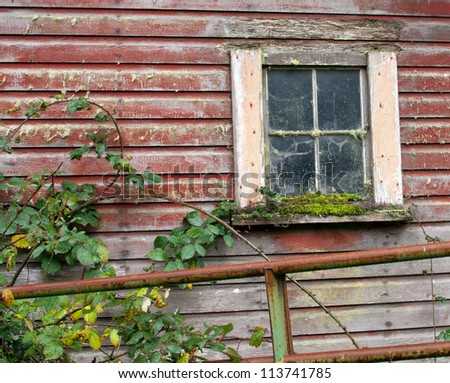 Old barn window. Countryside. Red barn