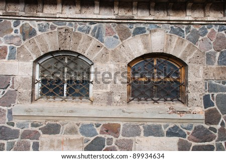 Old barn window with iron grille