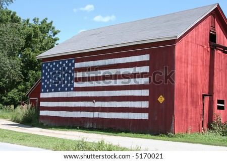 Old Barn with the American Flag painted on the side. - stock photo