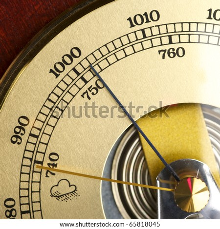 Old barometer forecasting stormy weather - stock photo