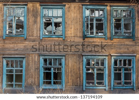 Old barrack wall with broken windows  - stock photo