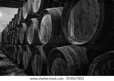 Old barrels for Whisky or wine on black and white - stock photo