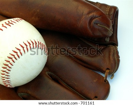 old baseball glove and ball - stock photo