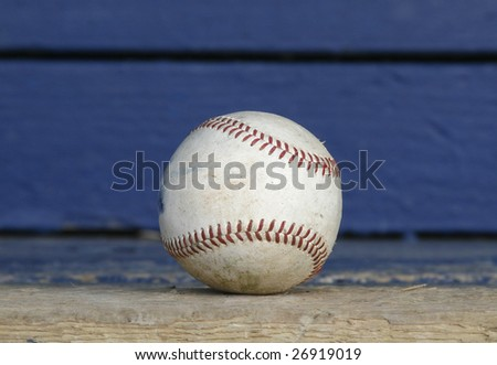 old baseball on a dugout bench