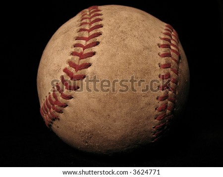 old baseball with black background