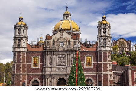 Old Basilica Christmas Tree Shrine of the Guadalupe Mexico City Mexico. Basilica construction started in 1531, finished 1709 where Virgin Mary appeared to the Mexican peasant Juan Diego. - stock photo