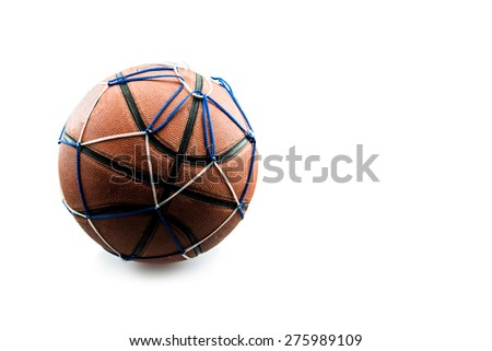 Old basketball ball in a net isolated on white background. - stock photo