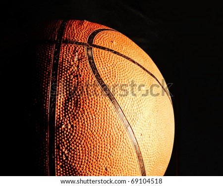 Old basketball ball in dark - stock photo