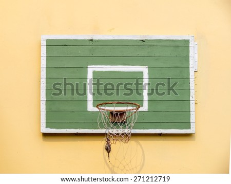 Old basketball hoop on empty outdoor court. - stock photo