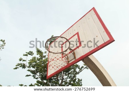 old basketball hoop without the net hang on it - stock photo