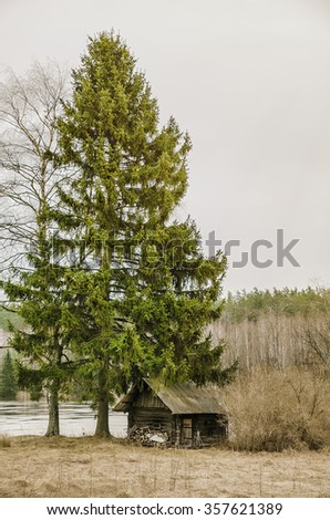 Old Bath-House On The River Bank - stock photo